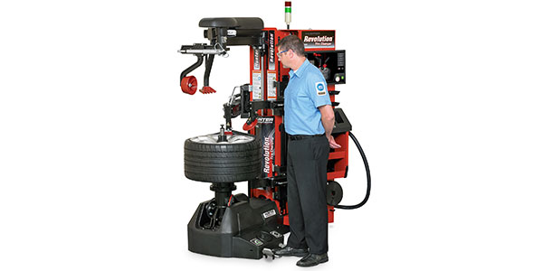 Revolution tire changer with WalkAway capability from Hunter Engineering