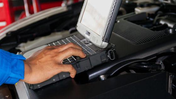 Tech using computer